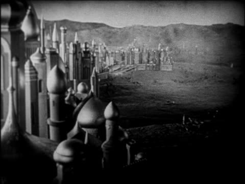 b/w 1924 wide shot magic carpet flying away from arabian city / feature - 1924 stock videos and b-roll footage