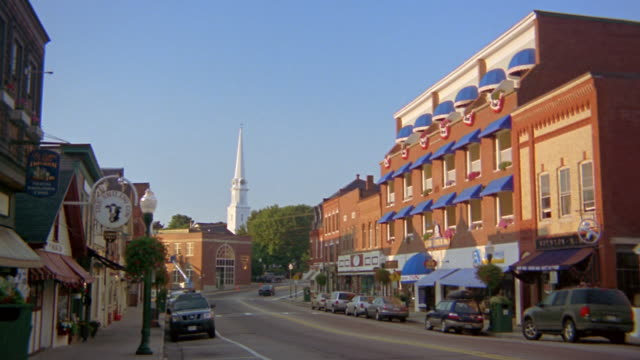Wide shot main street of small New England town in morning / Camden, Maine