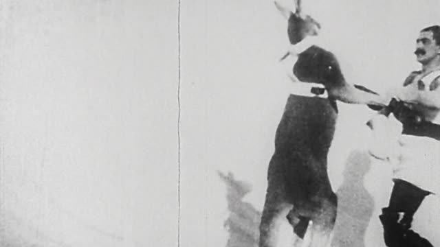 1895 wide shot man and kangaroo performing boxing act in german vaudeville show - känguru bildbanksvideor och videomaterial från bakom kulisserna