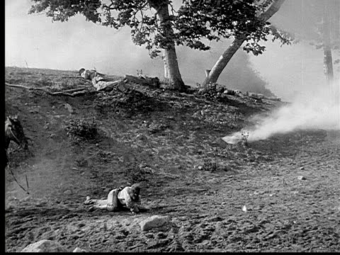 1913 b/w reenactment wide shot man falling off horse after explosion and followed by charging horse mounted cavalry during civil war battle reenactment / usa  - 1913 stock videos & royalty-free footage