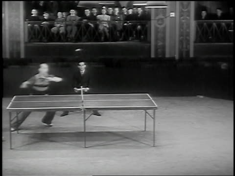 vídeos de stock, filmes e b-roll de b/w 1937 wide shot man playing table tennis with himself / judge + crowd on balcony watching in background /newark, nj - tênis de mesa