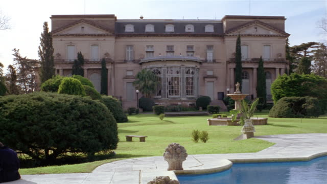 wide shot mansion and grounds with swimming pool in foreground - stately home stock videos & royalty-free footage