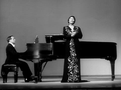 wide shot marian anderson singing ave maria onstage next to pianist during performance/ usa - 1951年点の映像素材/bロール