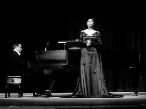 wide shot marian anderson singing onstage next to pianist during performance/ usa - formal glove stock videos and b-roll footage
