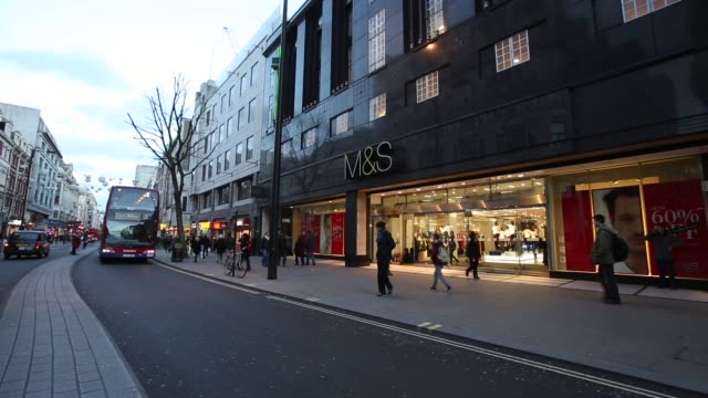 vídeos de stock e filmes b-roll de wide shot marks and spencer shop front on oxford street london members of the public walk past a branch of marks spencer on oxford street on january... - marks and spencer