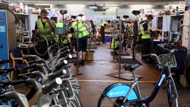 wide shot, mechanics repair damaged barclays cycle hire bikes in the mechanical workshop of the cycle hire's penton street depot on september 5, 2013... - new hire stock videos & royalty-free footage