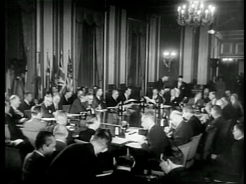 wide shot members of north atlantic council seated at large table in nato meeting / documentary - 1949 stock videos & royalty-free footage
