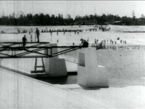 b/w 1934 wide shot pan men working on wpa reservoir construction project / atlantic city nj / documentary - new deal stock-videos und b-roll-filmmaterial