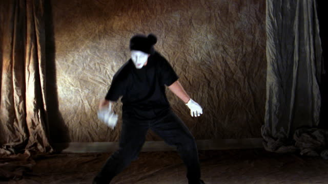 wide shot mime pushing imaginary oar - modern dancing stock videos & royalty-free footage