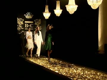 wide shot models parading down catwalk below chandeliers during b&c european style fashion show rehearsal/ belgrade, serbia  - sfilata di moda video stock e b–roll