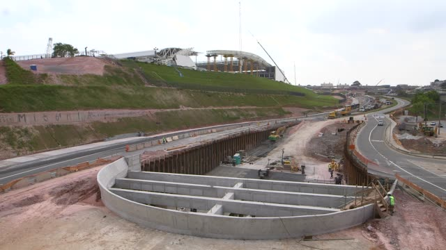 stockvideo's en b-roll-footage met wide shot motorway stadium link under construction a tragic accident at arena de sao paulo led to the death of two workers when the roof collapsed... - schakel