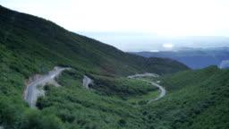 Wide shot mountain winding road