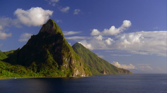 wide shot mountainous islands / time lapse clouds moving in background / st lucia - whatif点の映像素材/bロール