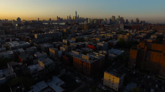 Wide shot moving over Hoboken toward One World Trade Center and NYC in the distance