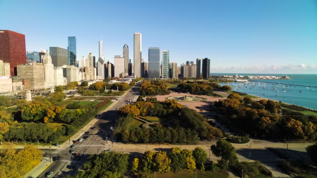 Wide shot moving toward Chicago skyline over Grant Park and Buckingham Fountain