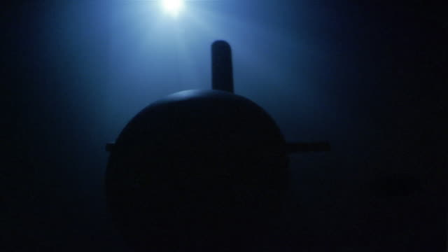 Wide shot nuclear submarine cruising underwater in Pacific Ocean / California