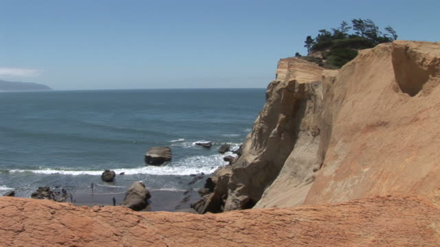 wide shot of a beach in oregon coast united states - oregon coast stock videos & royalty-free footage