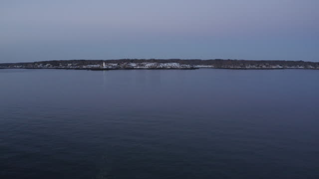 wide shot of a beam of light from the portland head light rotating over the ocean - north atlantic ocean stock videos & royalty-free footage