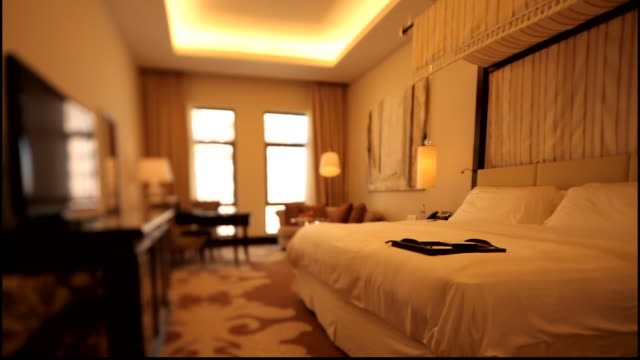 wide shot of a beautifully decorated five star hotel room. - hotel stock videos & royalty-free footage