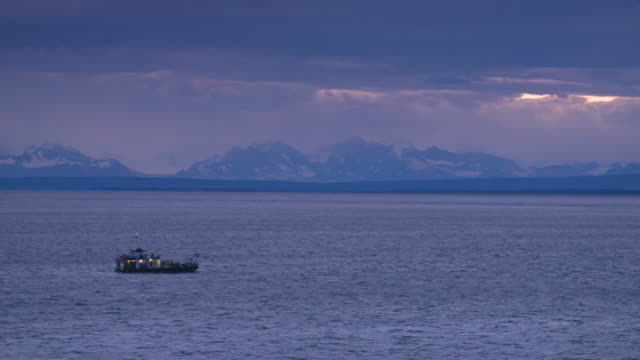 wide shot of a boat floating on the water - anchorage alaska stock videos and b-roll footage