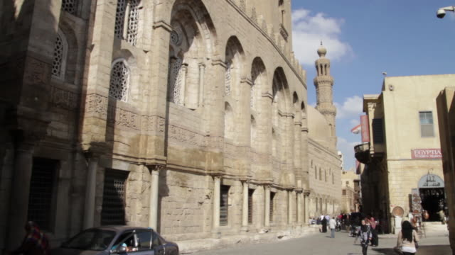 wide shot of a building in coptic cairo egyptian man exits his car - babylon stock videos and b-roll footage