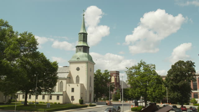 Wide shot of a church with green copper steeple in Boston, Massachusetts, USA.