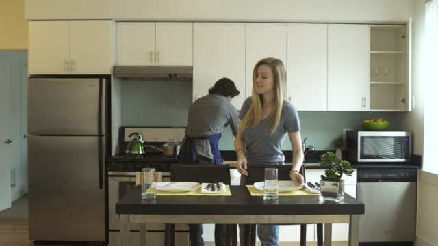 Wide shot of a couple cooking together
