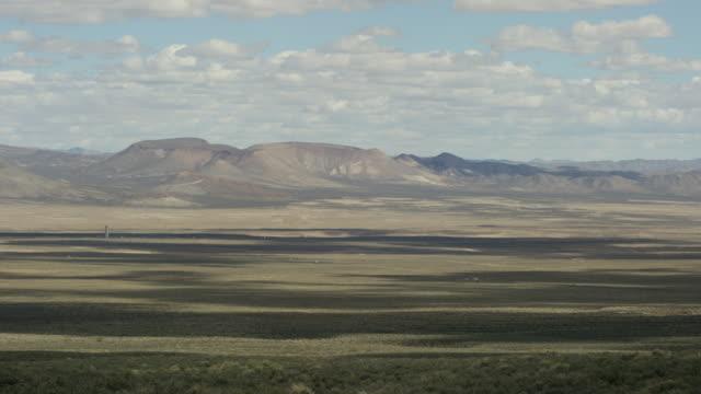 wide shot of a desert at nevada test site - massenvernichtungswaffe stock-videos und b-roll-filmmaterial