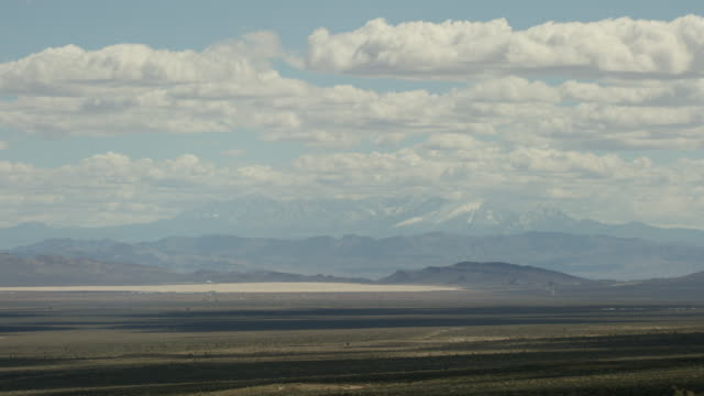 wide shot of a desert at nevada test site - atombombe stock-videos und b-roll-filmmaterial