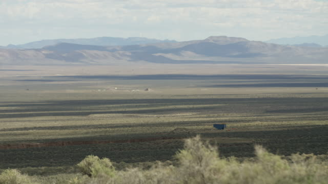 wide shot of a desert at nevada test site - weapons of mass destruction stock videos and b-roll footage