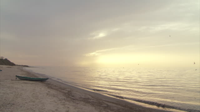 wide shot of a hazy sunset over a beach in gaza - gaza strip stock videos & royalty-free footage