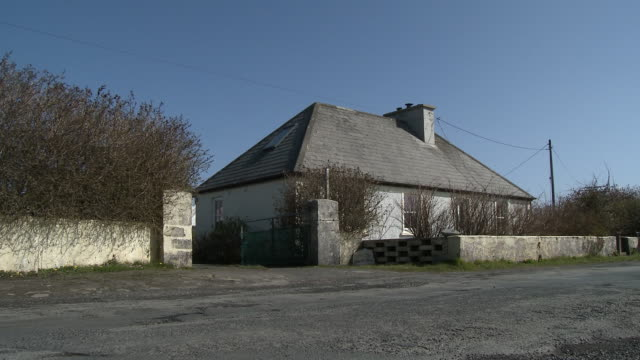 wide shot of a house from across the road - concrete wall stock videos & royalty-free footage