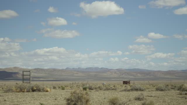 wide shot of a house in a desert at nevada test site - massenvernichtungswaffe stock-videos und b-roll-filmmaterial