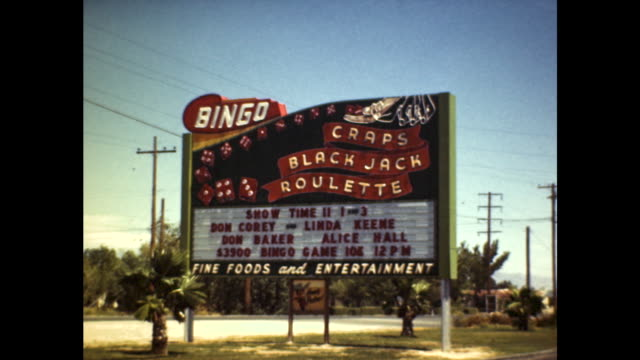 stockvideo's en b-roll-footage met wide shot of a large sign that reads bingo craps black jack roulette featuring performances by don corey linda keene don baker and alice hall - bingo