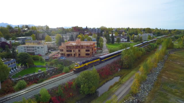 wide shot of a passenger train running through anchorage - anchorage alaska stock videos & royalty-free footage