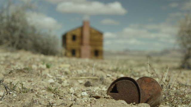 wide shot of a rusty can in front of a house at nevada test site - atomic bomb stock videos & royalty-free footage