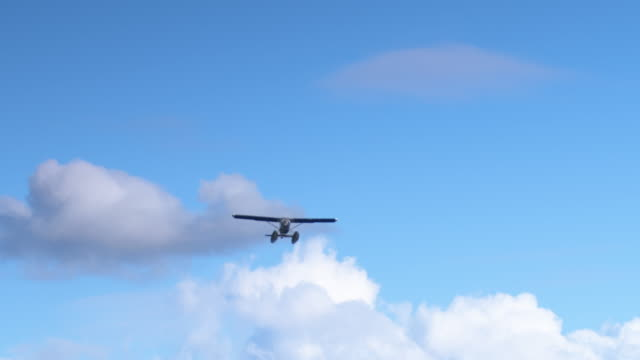 Wide shot of a seaplane flying