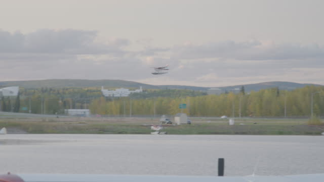wide shot of a seaplane landing on the water - splashdown stock videos & royalty-free footage