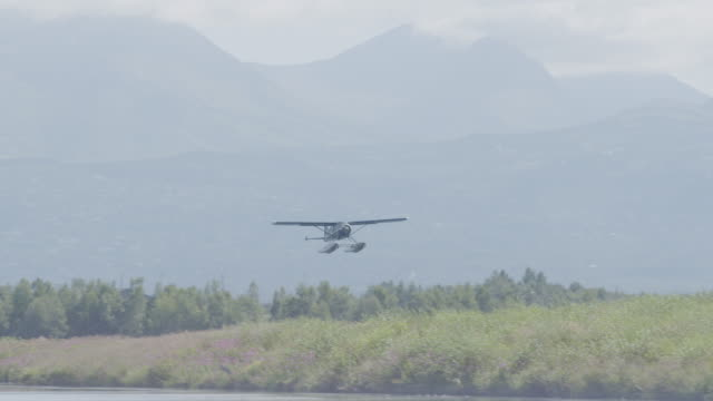 wide shot of a seaplane taking off - anchorage alaska stock videos & royalty-free footage