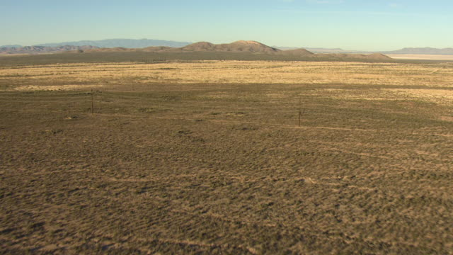 wide shot of a shrubland with hills in the background in arizona - shrubland stock videos & royalty-free footage