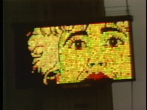wide shot of a times square intersection zooms in on an electric sign that advertises the 1987 film who's that girl starring madonna and griffin... - film premiere stock videos & royalty-free footage