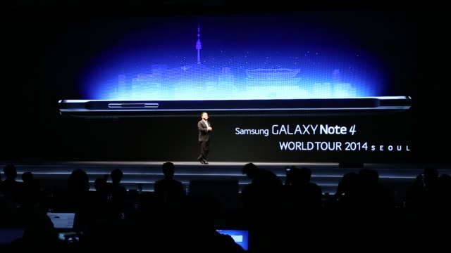 wide shot of a video presentation at the samsung galaxy launch event in seoul south korea - launchparty stock-videos und b-roll-filmmaterial
