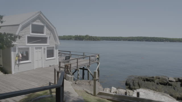 Wide shot of a waterfront house in Boothbay Harbor