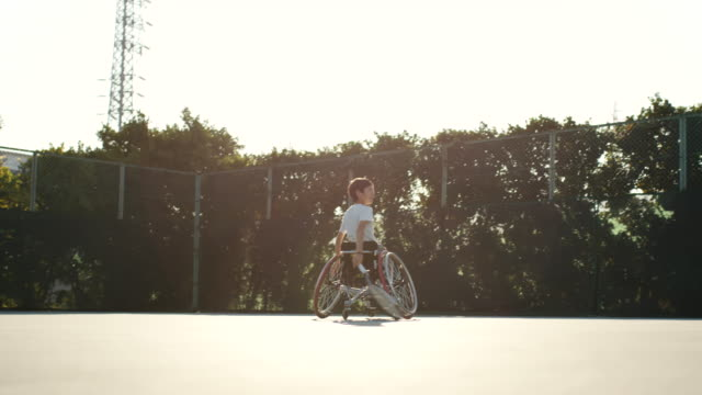 slo mo wide shot of an adaptive tennis players playing doubles - drive ball sports stock videos & royalty-free footage