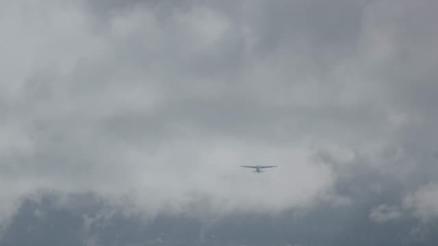 wide shot of an airplane taking off at juneau international airport - juneau stock videos and b-roll footage