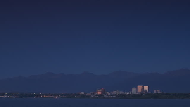 wide shot of anchorage cityscape at night - anchorage alaska stock videos & royalty-free footage