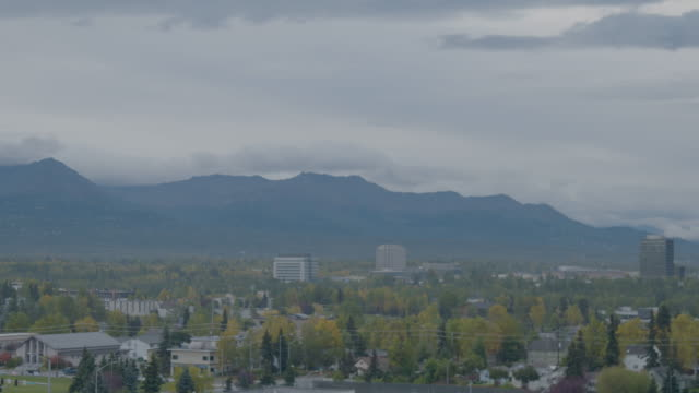 wide shot of anchorage cityscape with mountains in the background - anchorage alaska stock videos & royalty-free footage