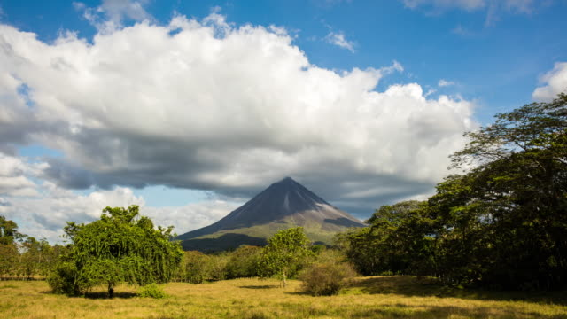 t/l 8k wide shot of arenal volcano in clouds - costa rica stock videos & royalty-free footage