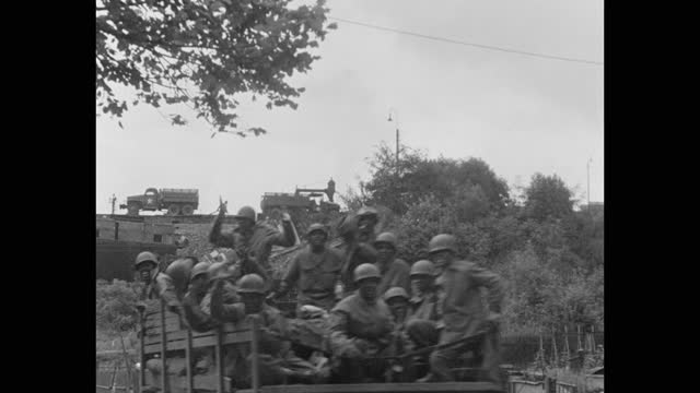 wide shot of army soldiers sitting in military trucks with train passing on hill in background, post wwii germany - postwar stock videos & royalty-free footage
