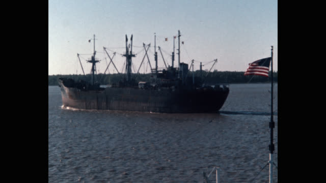wide shot of barge and ship moving in sea - patriotism stock videos & royalty-free footage